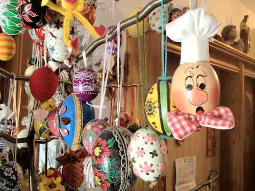decorated eggs hanging on an Easter tree