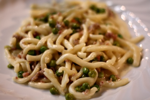 Strozzapreti with peas, ham, and cream sauce